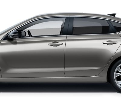 The new Hyundai i30 Fastback pictured from the driver side, focused on the doors roof, windows, and doors